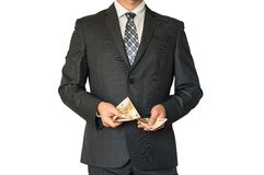 Man in business suit counting money Stock Photo