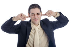Man in business suit covering his ears with his finger. Royalty Free Stock Photos