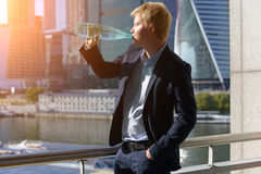Man in a business suit drinking. Water from a bottle Stock Images