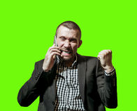 A man in a business suit an emotionally speaks on the phone Royalty Free Stock Images