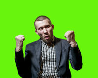 A man in a business suit happy success emotionally. Isolated on green background Stock Images