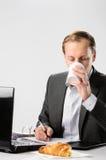 Man in business suit has caffeine coffee fix Stock Photos