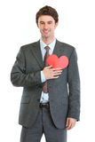 Man in business suit with heart shaped postcard Stock Photo