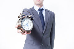 Man in Business Suit holding a clock - on time and business concept Royalty Free Stock Photo