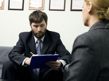 Man in a business suit holding a job interview. Ready for interview. Royalty Free Stock Images