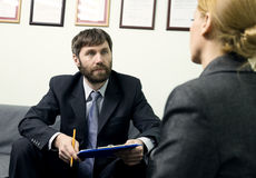 Man in a business suit holding a job interview. Ready for interview. Royalty Free Stock Photography