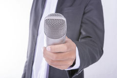Man in business suit holding microphone - interview concept Royalty Free Stock Photo