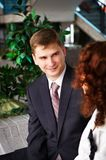 Man in business suit looks at woman gently Royalty Free Stock Photo