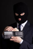 Man in business suit and mask holding leather purse with euro ba Stock Photo