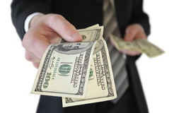 Man in a business suit put money in your pocket Royalty Free Stock Images
