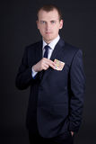 Man in business suit putting euro banknote into pocket Royalty Free Stock Image