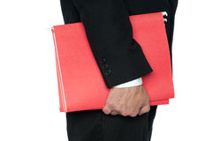 A man in a business suit red file folders Stock Image