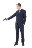 Man in business suit shooting with handgun isolated on white stock images