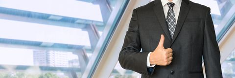 Man in business suit showing symbol OK. In office Stock Photography
