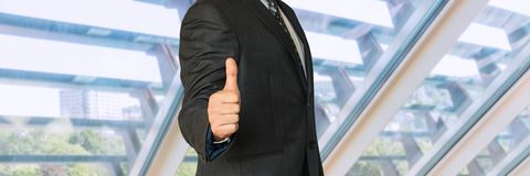 Man in business suit showing symbol OK. In office Royalty Free Stock Image