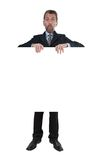 Man in business suit shows on billboard Royalty Free Stock Photos