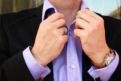 A man in a business suit straightens his shirt Royalty Free Stock Photography