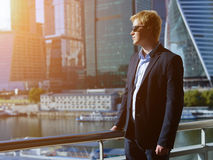 The man in a business suit. Sunny day Royalty Free Stock Image
