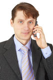 Man in business suit talking on phone Royalty Free Stock Image