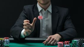Man in business suit tossing chips to make decision about bets, gambling slow-mo. Stock footage stock video footage