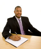 Man in Business Suit Writing in Notebook Royalty Free Stock Photo