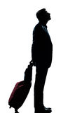 Man business traveler waiting looking up. One caucasian man business traveler waiting looking up full length silhouette in studio isolated white background Stock Photography