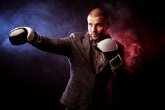 Man businessman in gray suit and boxing gloves stock photo