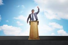 The man businessman making speech at rostrum in business concept. Man businessman making speech at rostrum in business concept Stock Photography