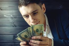 Businessman, member or officer puts a bribe in his pocket Royalty Free Stock Photography