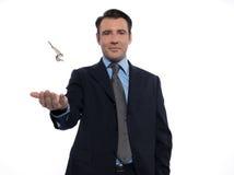 Man Businessman realtor teasing holding keys Royalty Free Stock Images
