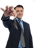 Man Businessman realtor teasing offering keys Royalty Free Stock Photo