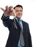 Man Businessman realtor teasing offering keys Royalty Free Stock Photo