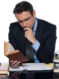 Man businessman teacher   reading. Man caucasian teacher professor reading concentrated isolated studio on white background Royalty Free Stock Photos