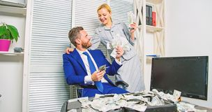 Man businessman and woman secretary with pile dollar banknotes. Profit and richness concept. Businessman near cash royalty free stock photo