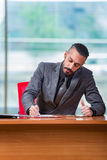 The man businessman working at this desk. Man businessman working at this desk Royalty Free Stock Photo