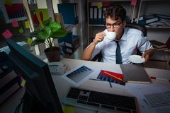 The man businessman working late hours in the office. Man businessman working late hours in the office stock image