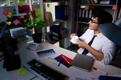 The man businessman working late hours in the office. Man businessman working late hours in the office royalty free stock images
