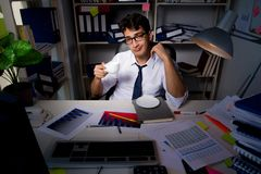 The man businessman working late hours in the office. Man businessman working late hours in the office stock photos