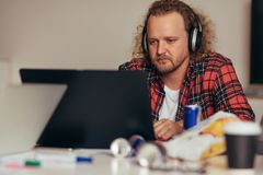 Man busy coding on laptop t tech startup royalty free stock image