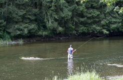 Man busy with flyfishing. In the belgium river semois ner the place auby sur semois Stock Photos