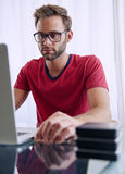 Man busy inserting a memory stick into his notebook Royalty Free Stock Photos