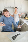 Man busy with technology while his wife wondering why Royalty Free Stock Images