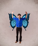 Man  with butterfly blue illustration on the back Royalty Free Stock Image