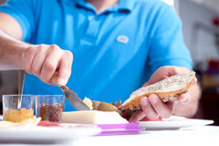 Man buttering a slice of wholewheat bread Royalty Free Stock Photo