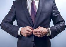 Man buttoning dark jacket Royalty Free Stock Photo