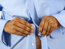 Man buttoning his shirt Royalty Free Stock Image