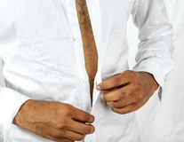 Man buttoning his shirt Royalty Free Stock Photography