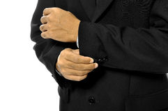 Man Buttoning His Sleeve Stock Images