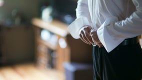 Man buttoning shirt closeup. Dressed man. Dressing up men`s. Men hands. stock video