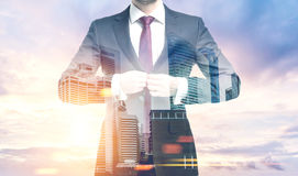 Man buttoning a suit in a morning city Stock Image